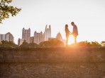 Couple with sunflare at Atlanta park