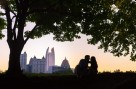 silhouette of couple with Atlanta's city skyline