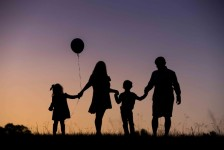 Silhouette of family and balloon