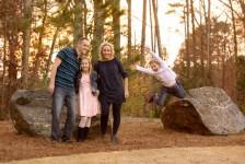 Boy jumping through air photobomb