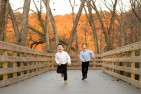 Boys running through leaves by Chattahoochee River