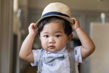 Litte boy with adorable hat and bow tie