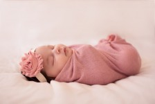 Swaddled baby girl with headband