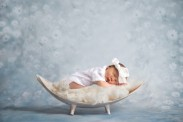 Baby Girl sleeping on blanket in wooden basket