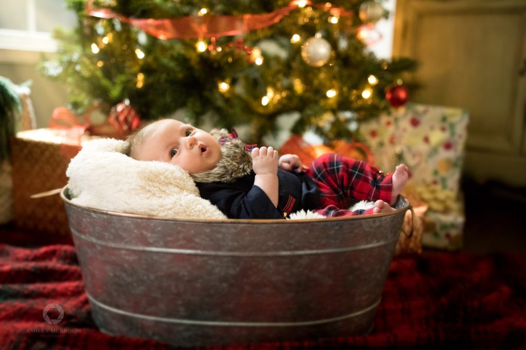 atlanta newborn photographer baby in a bucket by christmas tree