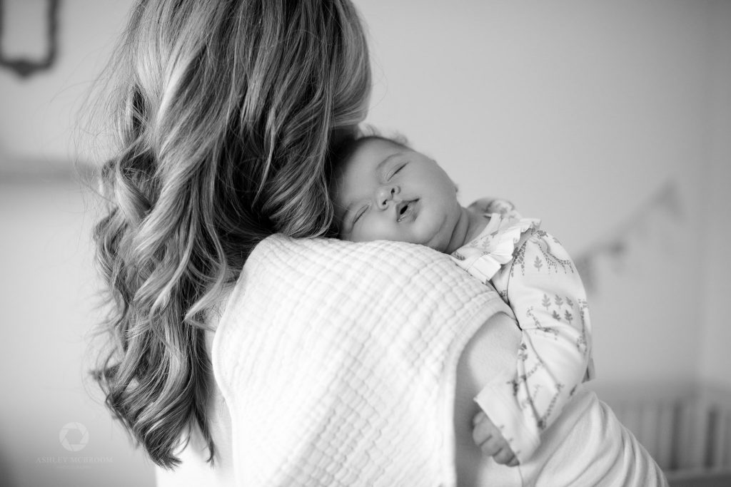 newborn photographer in atlanta when baby fell asleep on mom's shoulder