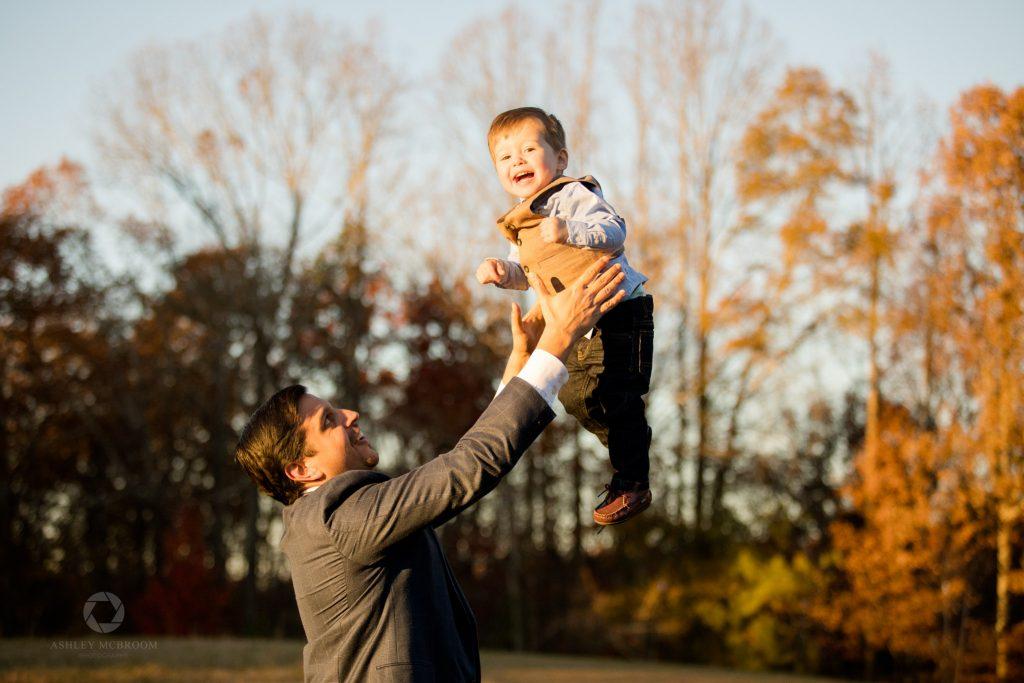 Little boy being thrown up in air by dad