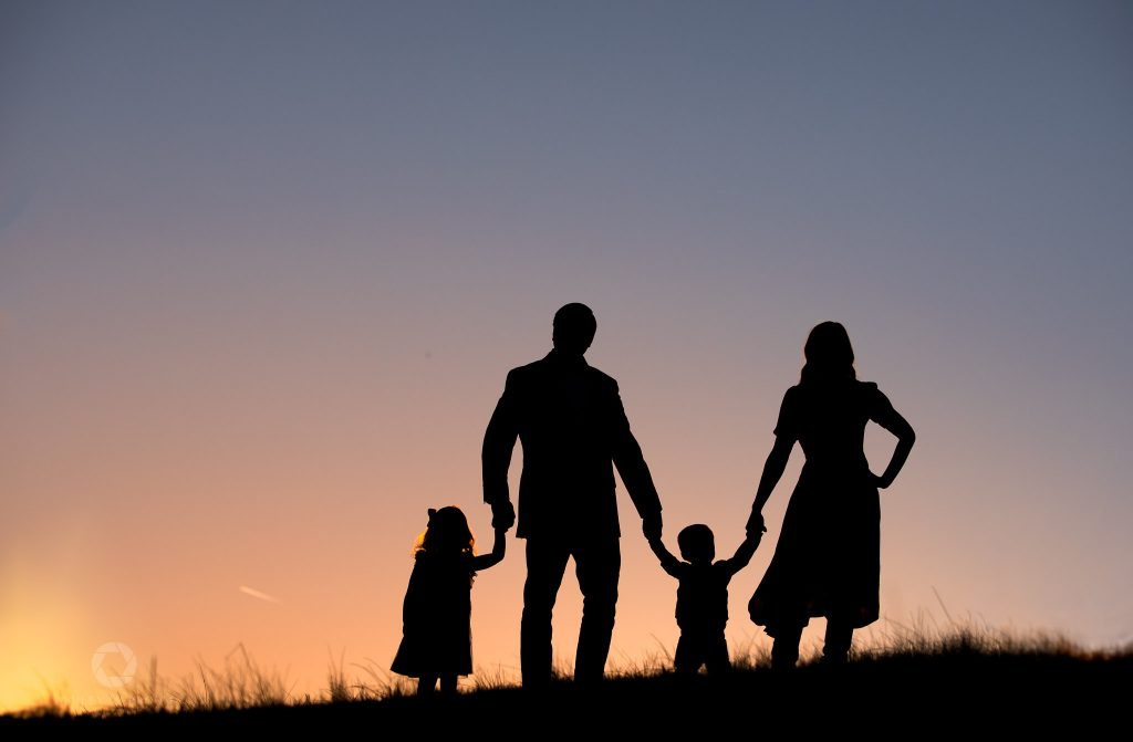 Silhouette of family at sunset roswell photographer