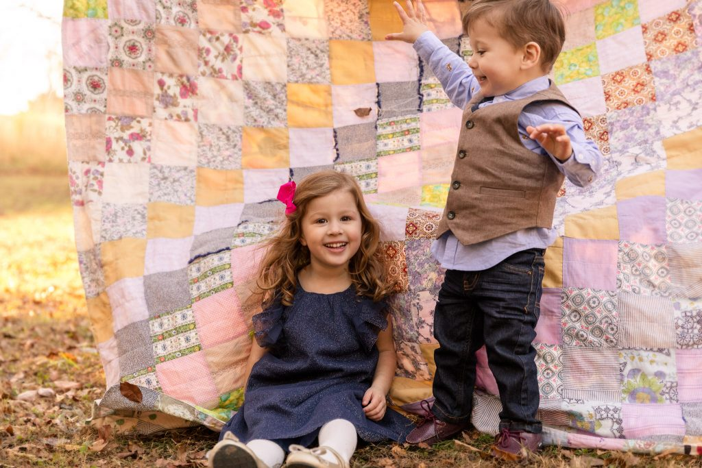 Cute kids with grandmothers quilt