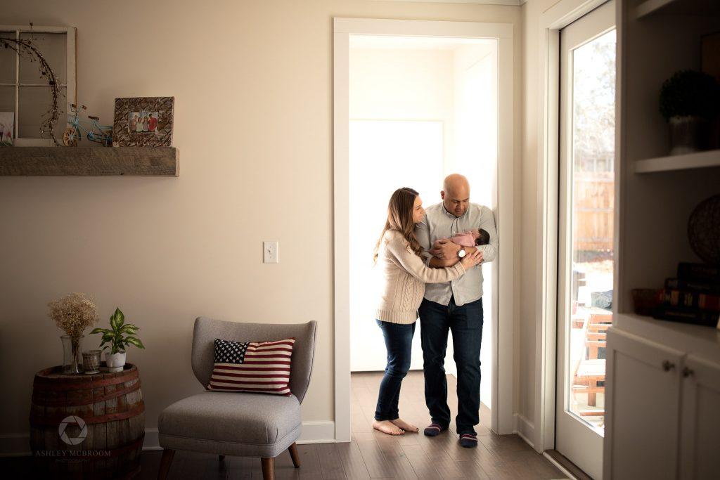 family of 3 in doorway lifestyle shot