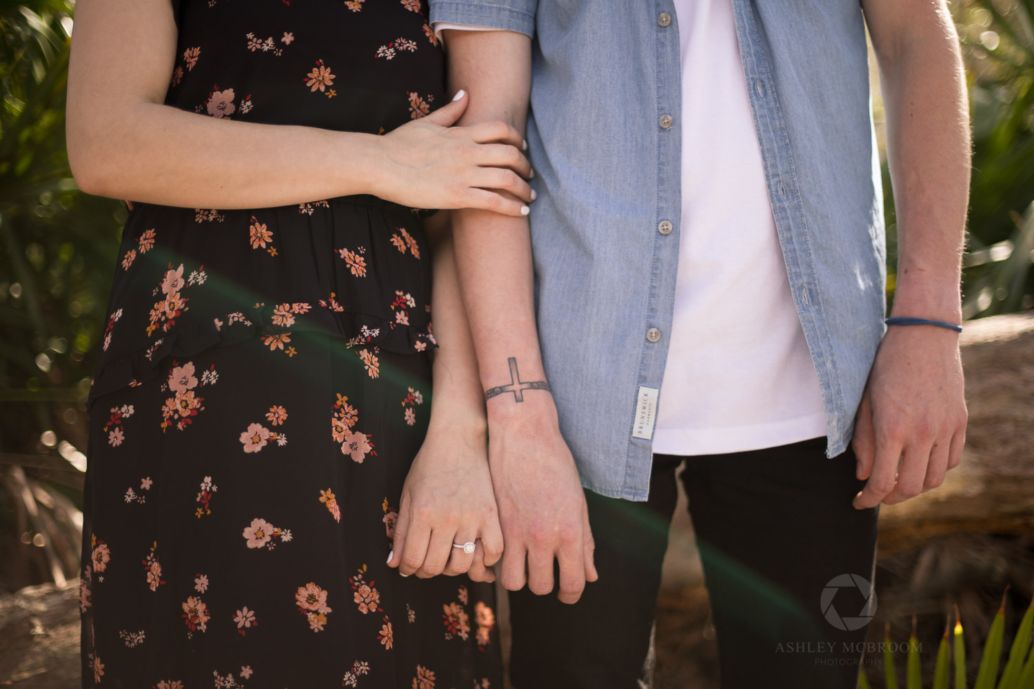 tattoos and engagement ring detail shot