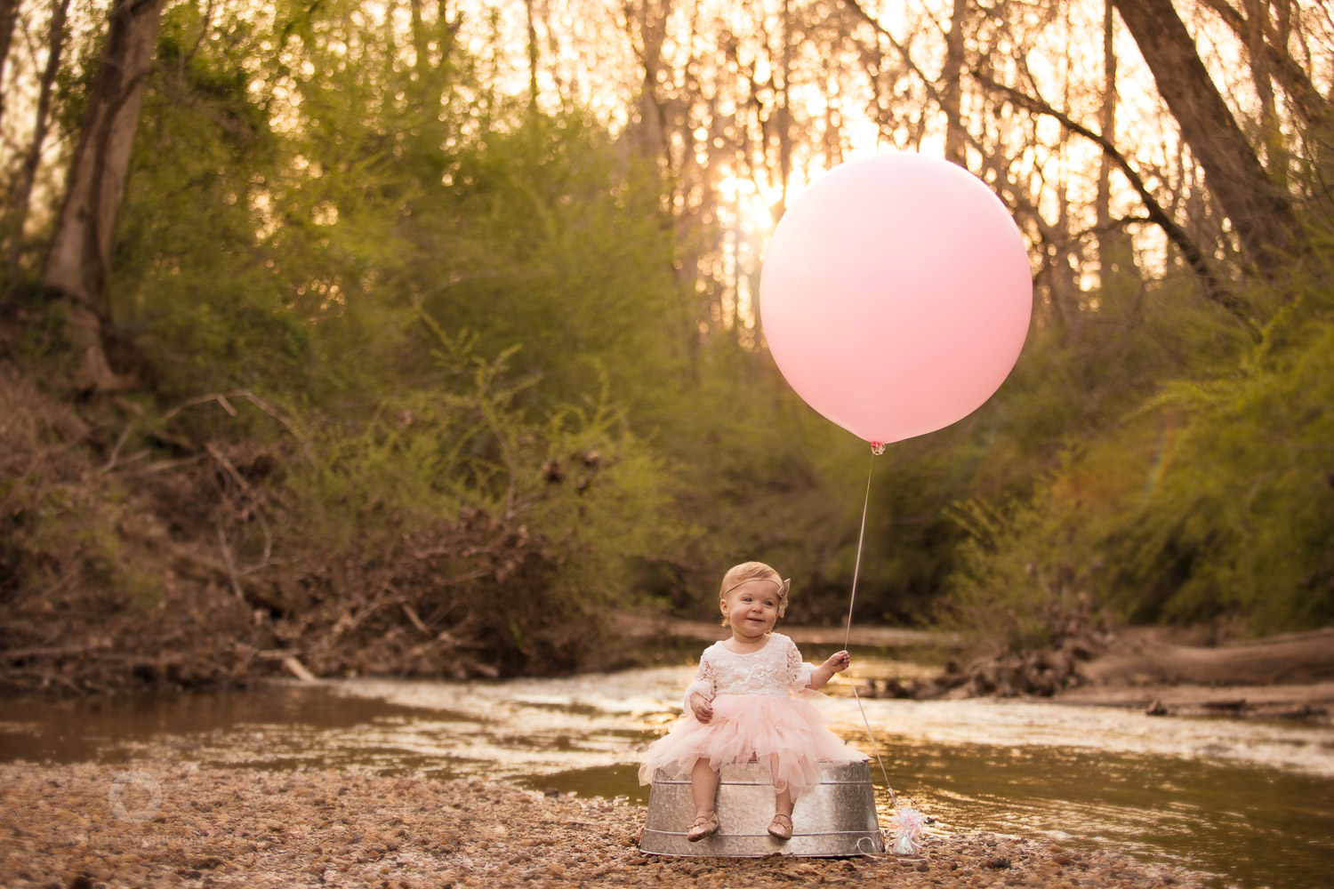 Little girl with balloon in east cobb park