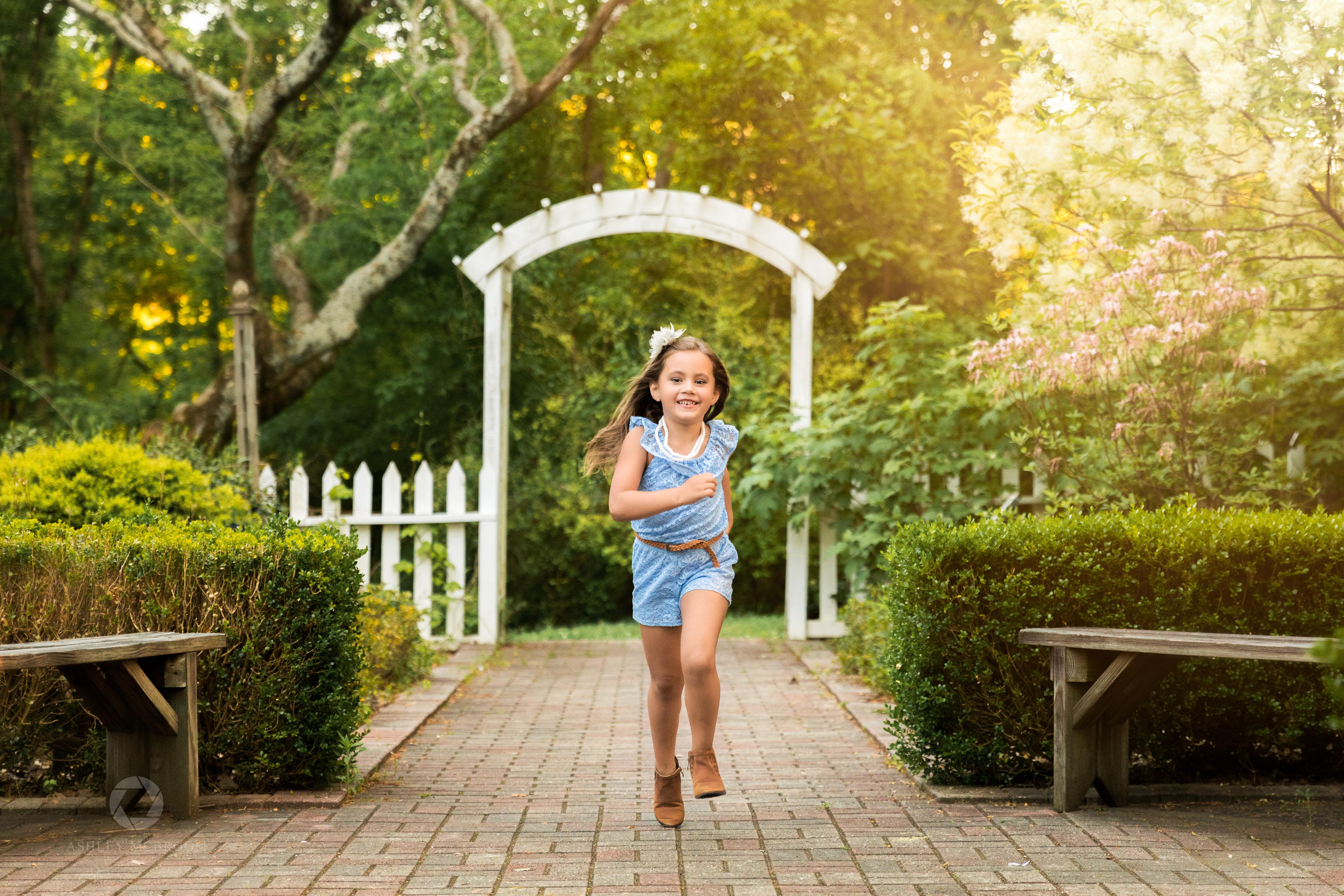 girl running through garden