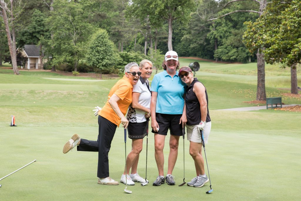 women having fun on golf course