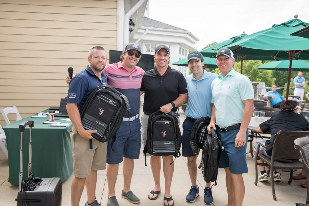 Golfers collecting their prize at atlanta charity event