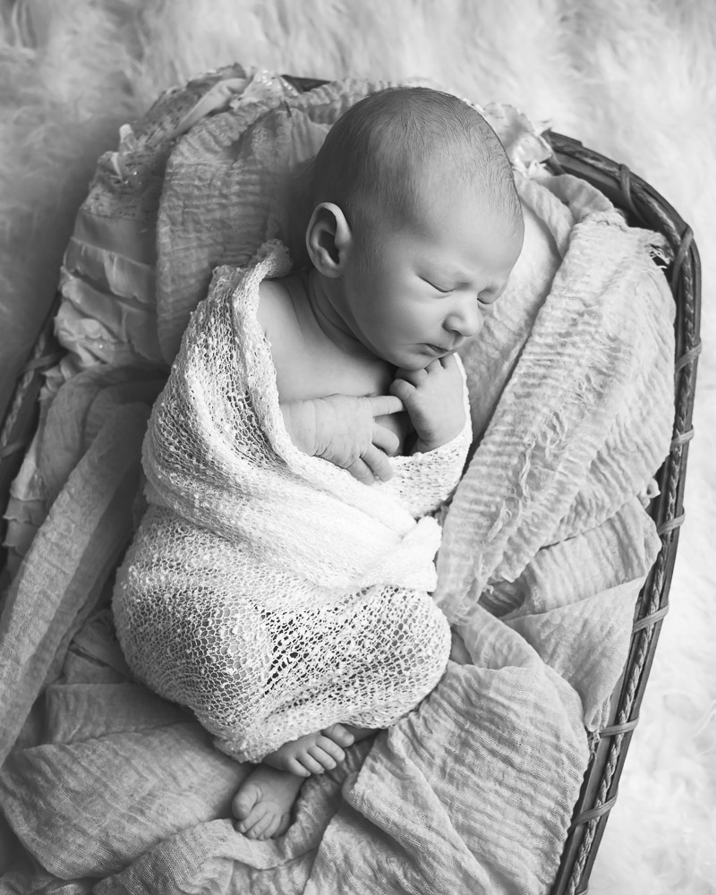 black and white photograph of newborn in roswell ga