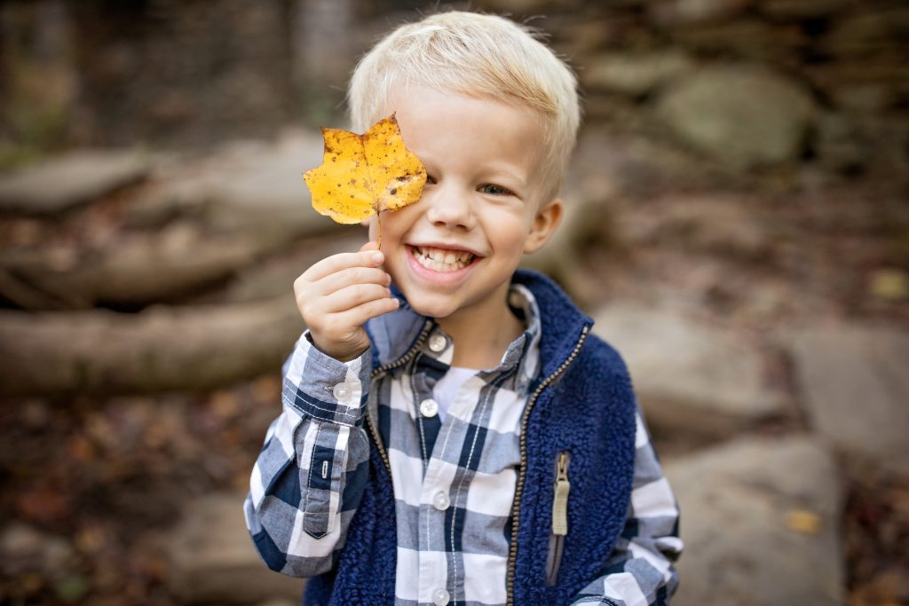 little boy holding a yellow leaf in georgia