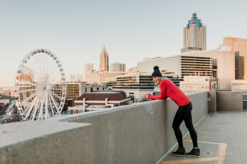 woman in exercise clothes with city backdrop