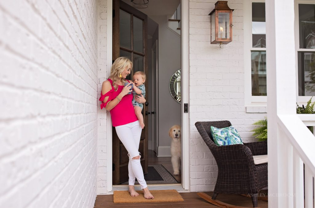 mom at beautiful home in Brookhaven GA by front door with baby