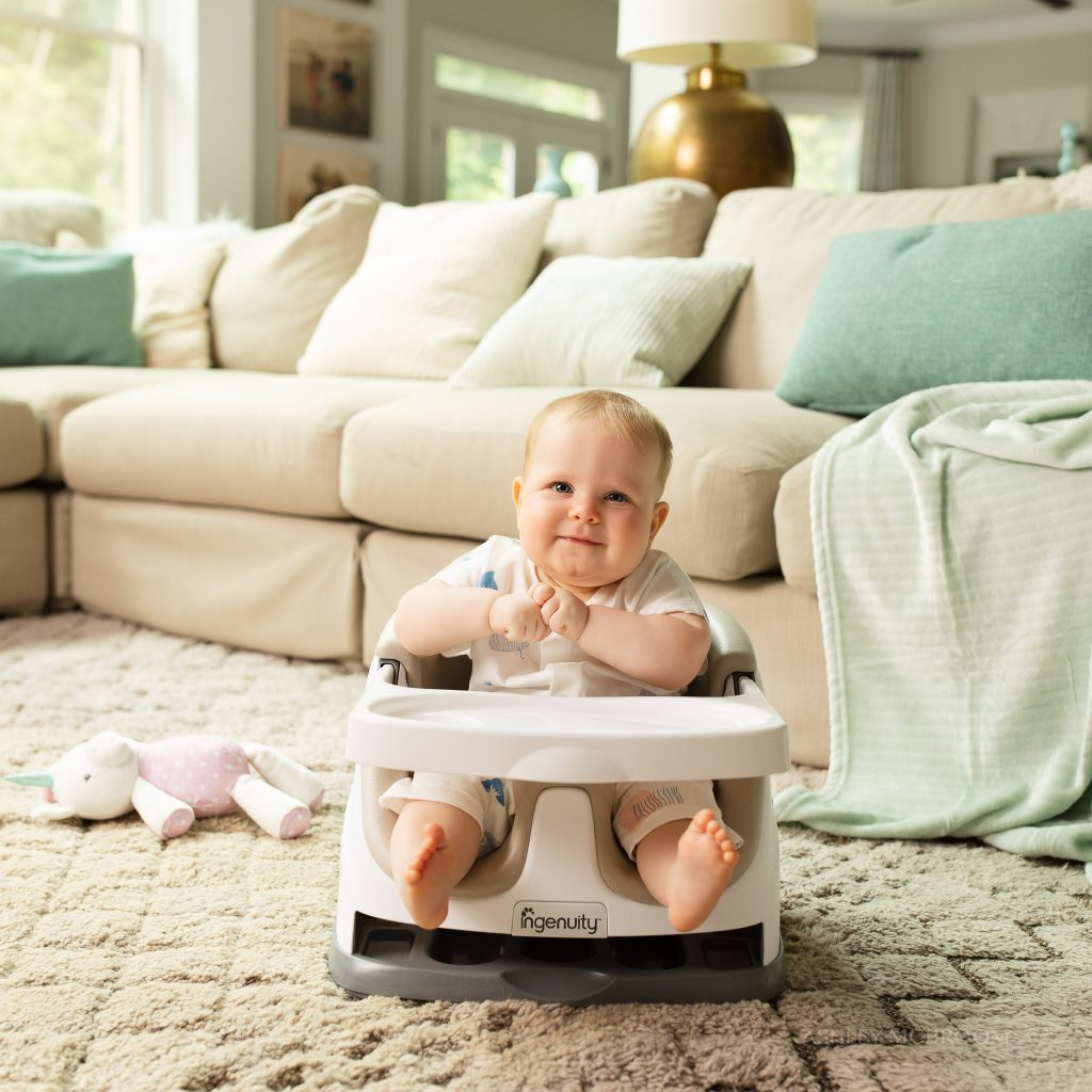 baby in booster seat