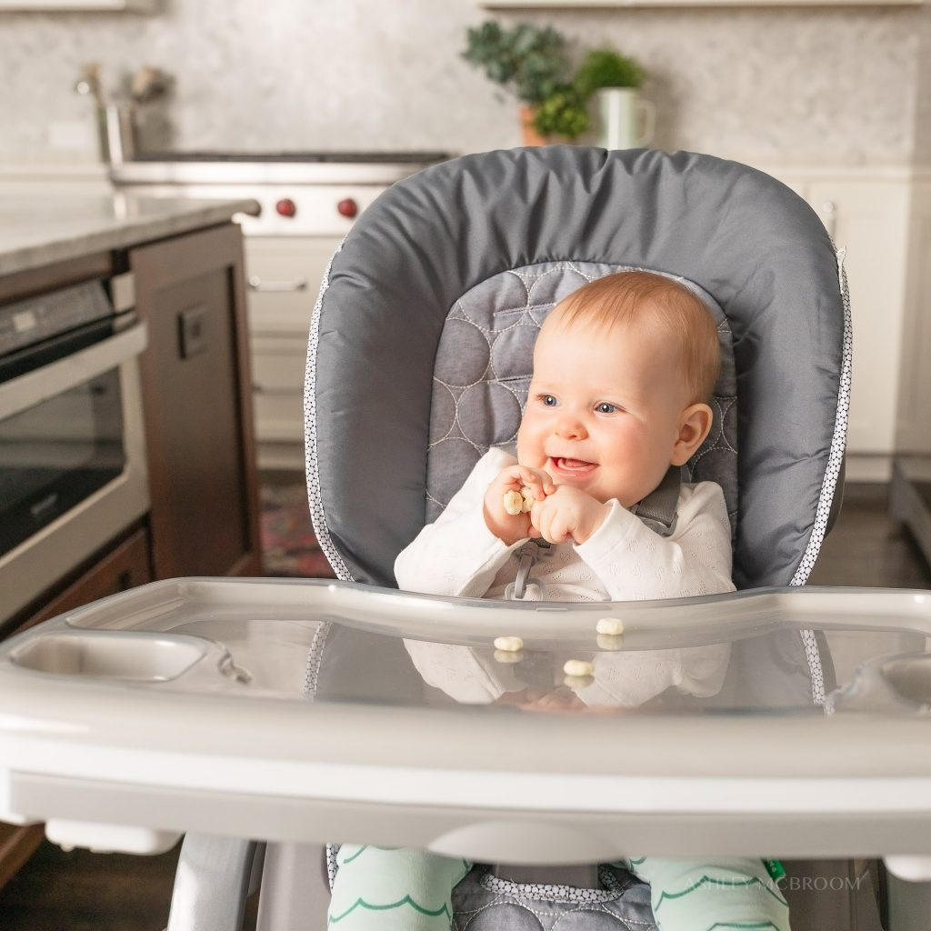 happy baby in highchair commercial photography