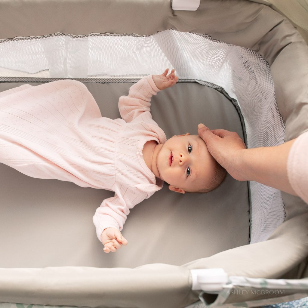 baby in bassinet during commercial shoot