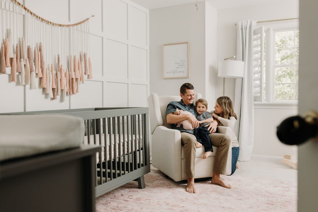 family cuddle during in-home newborn session in marietta